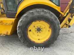 2002 New Holland 555E 2wd Tractor Loader Backhoe with Cab 4-1 Bucket Extend-A-Hoe