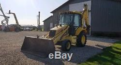 2002 New Holland LB75B 4x4 Extendable Stick Enclosed Cab Heat Backhoe Loader