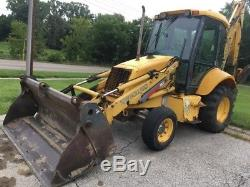 2003 New Holland LB75. B Tractor Loader Backhoe with Cab & Extenda Hoe! Coming Soon