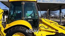2004 New Holland LB75. B Tractor Loader Backhoe with Cab & Extenda Hoe