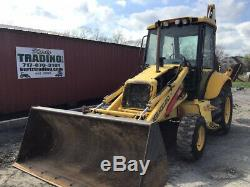 2005 New Holland LB75. B 4x4 Tractor Loader Backhoe with Cab CHEAP