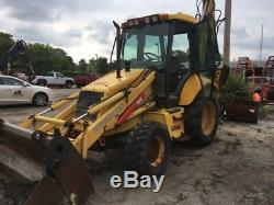 2005 New Holland LB75. B Tractor Loader Backhoe with Cab & Extenda Hoe! Coming Soon