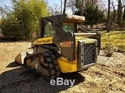 2011 New Holland C175 skid steer loader 1350 hrs. Enclosed cab 2 spd new tracks