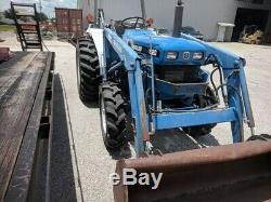 New Holland 1920 Tractor with Loader, Backhoe and 4 ft. Rotary Cutter