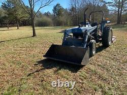 New Holland 4630 turbo tractor with bush hog loader