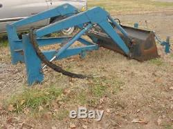 New Holland 7108 compact tractor loader