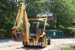 New Holland LB 75B back hoe front loader 4 wheel drive