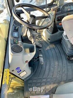 New Holland LB115 backhoe loader 4x4