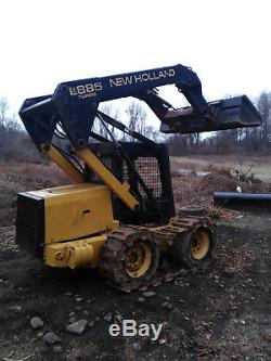 New Holland LX885 Skid steer loader. Tracks Available. Solid Rubber Tires