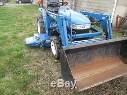 New Holland TC21d compact tractor with belly mower and loader nice one owner